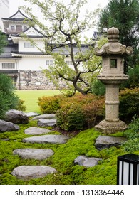 Traditional Japanese garden with Toyama castle at the background