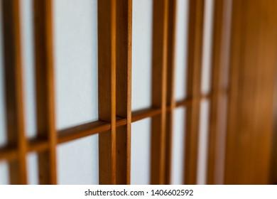 Traditional japanese house or ryokan with macro closeup of brown shoji sliding paper doors closed