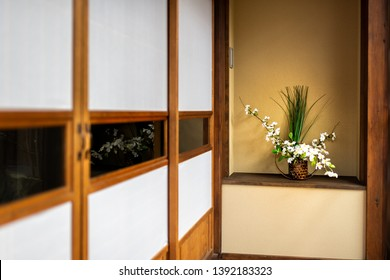 Traditional japanese house or ryokan with shoji sliding paper doors and ikebana decoration