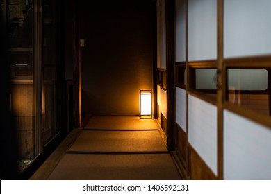 Traditional japanese house or ryokan with shoji sliding paper doors tatami mat floor and lamp at night