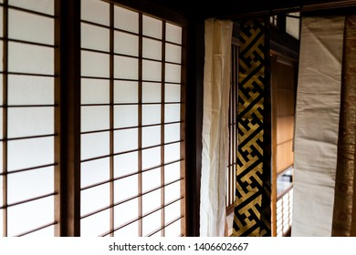 Traditional japanese house or ryokan with sliding paper door and light with architecture and hanging kimono obi sash
