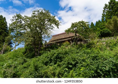 A traditional Japanese house with a thatched roof is built in the mountain, Japan.