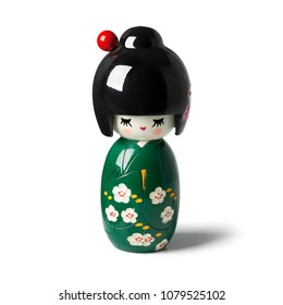 Traditional Japanese kokeshi doll isolated on white background