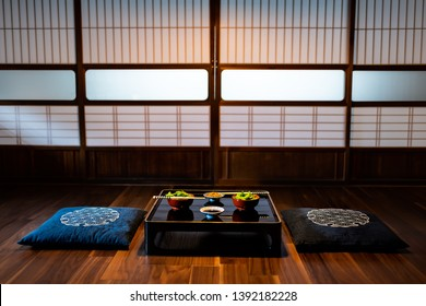 Traditional japanese machiya house or ryokan restaurant with black lacquered wood table and edamame soybeans food with natto and soy sauce