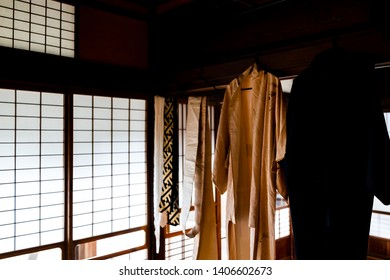 Traditional japanese machiya house or ryokan with sliding paper door and light with architecture and hanging kimono with sash