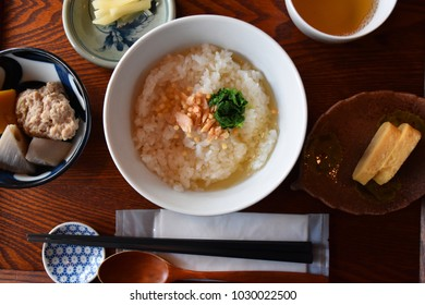 Traditional Japanese meal, popular for breakfast and late night support, called Ochazuke, simmered salmon on rice in hot green tea soup