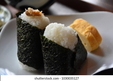 Traditional Japanese rice balls, called Onigiri, popular for breakfast, wrapped with seaweed, sometimes with dry and salty salmon in the middle or marinated plum inside