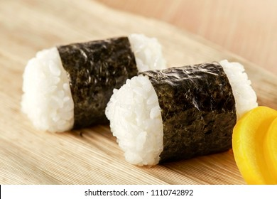 Traditional Japanese rice balls, called Onigiri, popular for breakfast, wrapped with seaweed