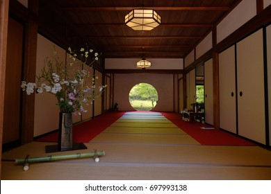 A traditional Japanese room with tatami and a round window, used to enjoy each season's scenery view. Japan. April 2017
