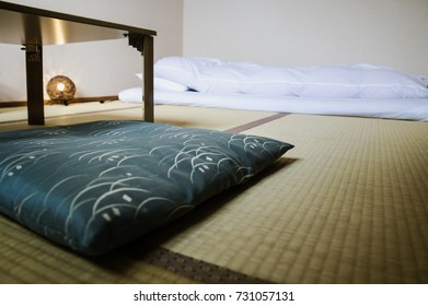 Traditional Japanese Ryokan room with tatimi mats and futon, pillow and table, Japan