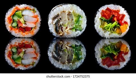 traditional japanese seafood, restaurant menu photo. set of fresh sushi rolls Sapporo Maki, Shimodo Maki and Fudzi Maki