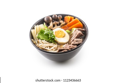 Traditional japanese soup ramen in bowl isolated on white background.