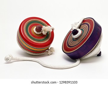 Traditional japanese spinning top toy with string.