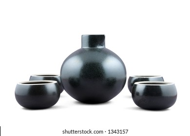 A traditional Japanese style Sake set comprising a jug and four bowl cups. Isolated with path.