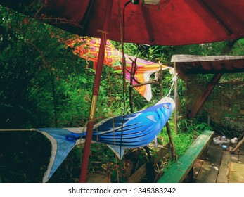 The traditional Japanese styled umbrella and the crossed carp streamers (banners) at the small park in Hiroshima, Japan