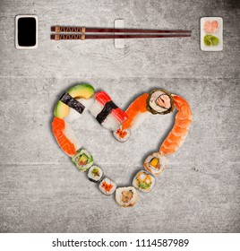 Traditional japanese sushi pieces making inscription and heart symbol. Very high resolution image.