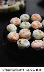 Traditional Japanese sushi roll black background