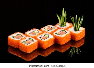 Traditional japanese sushi roll with salmon and red caviar,  close up isolated on a glossy black background