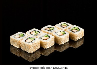 Traditional japanese sushi roll with sea eel, close up isolated on a glossy black background