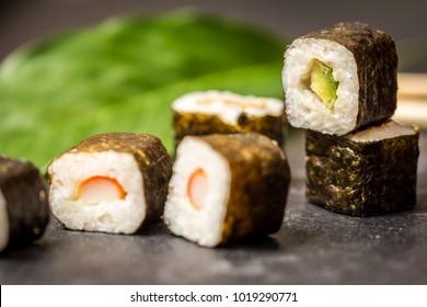 Traditional japanese sushi rolls hosomaki on stone desk