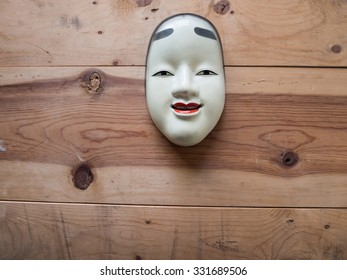 Traditional japanese theater masks made of iron on wood background