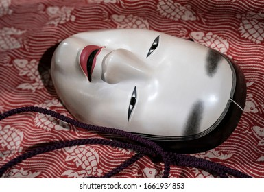 Traditional japanese theatre mask made from wood - Shutterstock ID 1661934853