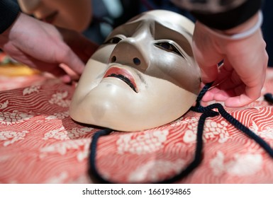 Traditional japanese theatre mask made from wood - Shutterstock ID 1661934865