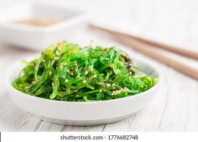 Traditional Japanese wakame salad with sesam seeds. Healthy and fresh seaweed salad.