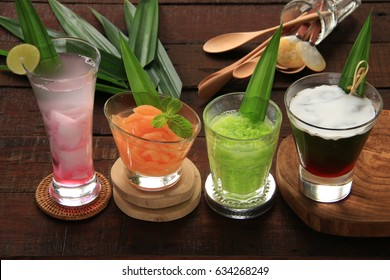 Traditional Javanese cold dessert drinks popular for breaking the fast during Ramadan and Eid periods; iced coconut jelly, iced cantaloupe, iced fermented green glutinous rice, and iced grass jelly.