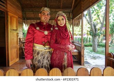 Traditional javanese wedding couple bride and bridegroom at garden