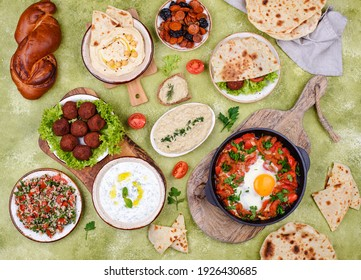 Traditional Jewish food. Hummus, falafel, shakshuka, tsimes, forshmak and pita