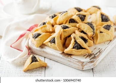 Traditional Jewish Hamantaschen cookies with berry jam. Purim celebration concept. Jewish carnival holiday background. Selective focus. Copy space.