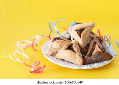 Traditional Jewish Hamantaschen cookies. Purim celebration concept. Jewish carnival holiday background.