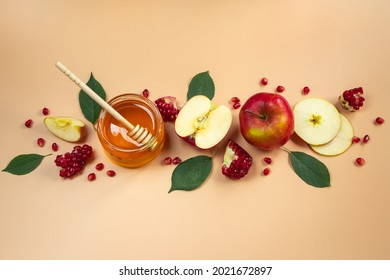 Traditional Jewish holiday New Year. Happy Rosh Hashanah. Apples, pomegranates and honey on a yellow background. Place for your text. - Shutterstock ID 2021672897