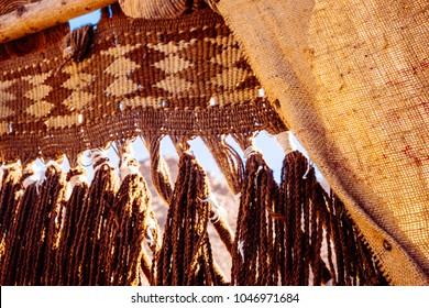 Traditional jute decoration at the entrance, closeup. In the desert near Dahab, Sinai, Egypt. Sackcloth or burlap tent.