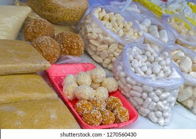 Traditional Kazakh food of salty & sweet curd. On left - national dessert named 'zhent' made of millet & honey