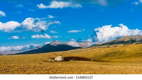 Traditional Kazakh yurt in the sunrise mountains. Kazakhstan. Central Asia.