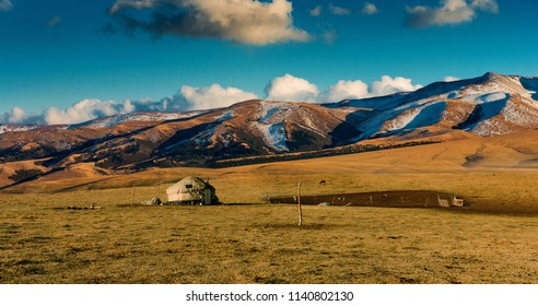 Traditional Kazakh yurt in the sunrise mountains. Kazakhstan. Central Asia.