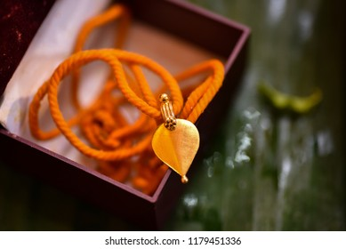 Traditional Kerala Hindu Wedding Knot popularly known as Thali/Tali. The pendent is in the shape of Banyan Tree Leaf hence known as Aalila Thali.