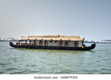 A traditional Kerala houseboat setting off in search of tourists in Alappuzha