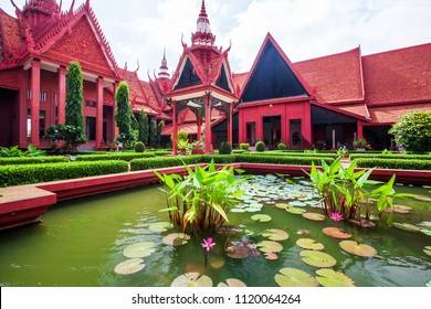 Traditional Khmer architecture and beautiful courtyard of the National Museum of Cambodia, lush pond with colorful lotus. Phnom Penh City, Cambodia. Bright sunlight. Public park, public museum.