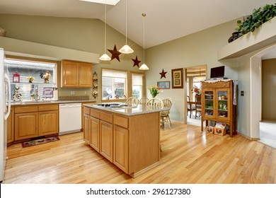 Traditional kitchen with dinning area and hardwood floor.