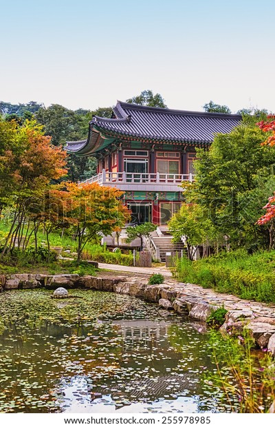 Traditional korean architecture old building or monks temple with little pond in South Korea at autumn