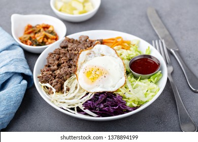 Traditional korean bibimbap with ground beef, vegetables and rice