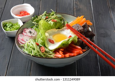 Traditional Korean dish- Bibimbap, rice with egg, beef and vegetables