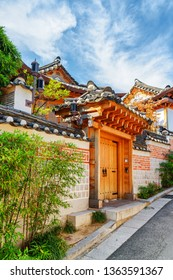 Traditional Korean houses of Bukchon Hanok Village in Seoul, South Korea. Beautiful cityscape on sunny day. Seoul is a popular tourist destination of Asia.