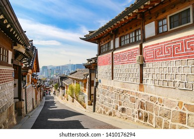 Traditional Korean style house at Bukchon hanok village    contrast with background of Seoul urban city and N seoul tower  location Seoul , South Korea date 16/4/2019