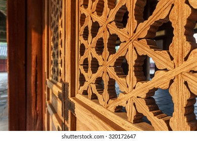 Traditional Korean window frame pattern illuminated by sunset