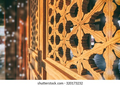 Traditional Korean window frame pattern illuminated by sunset. Bokeh effect
