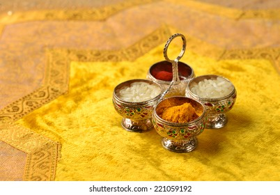 """The traditional Kumkum  powder and rice grains in a tiny silver container.  Kumkum is used as a """"Tilak"""" in India at auspicious occasion."""